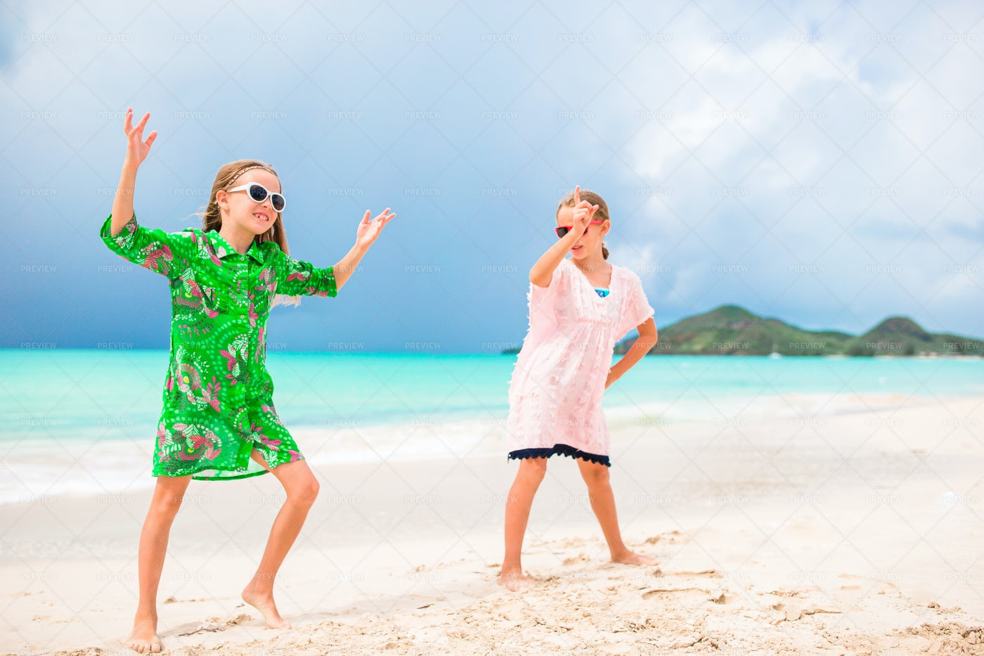 Sisters Dancing Together On Beach: Stock Photos