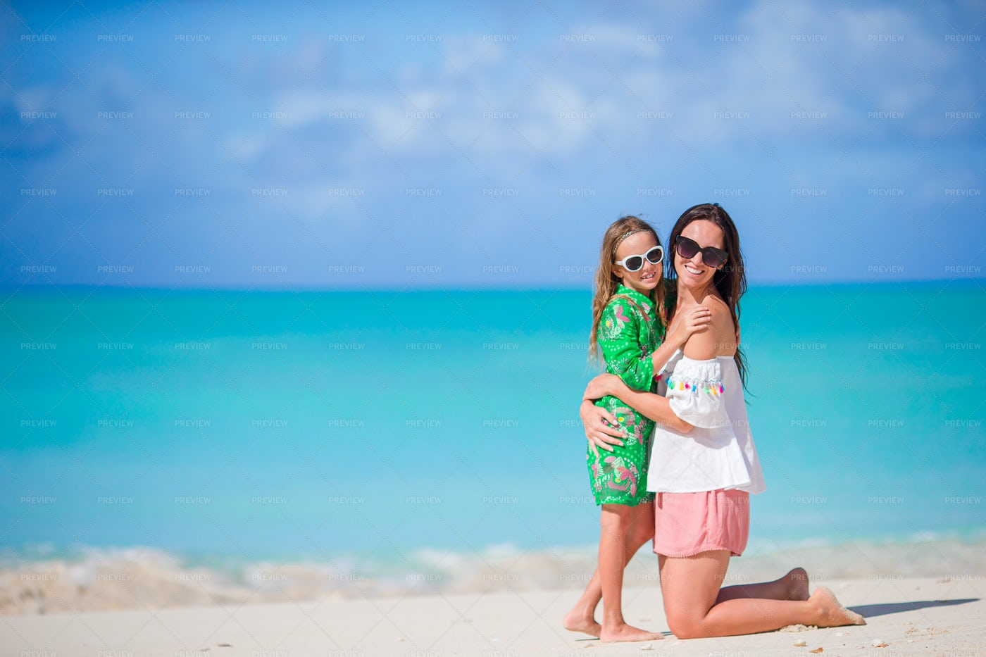 Mother And Daughter In The Sand: Stock Photos