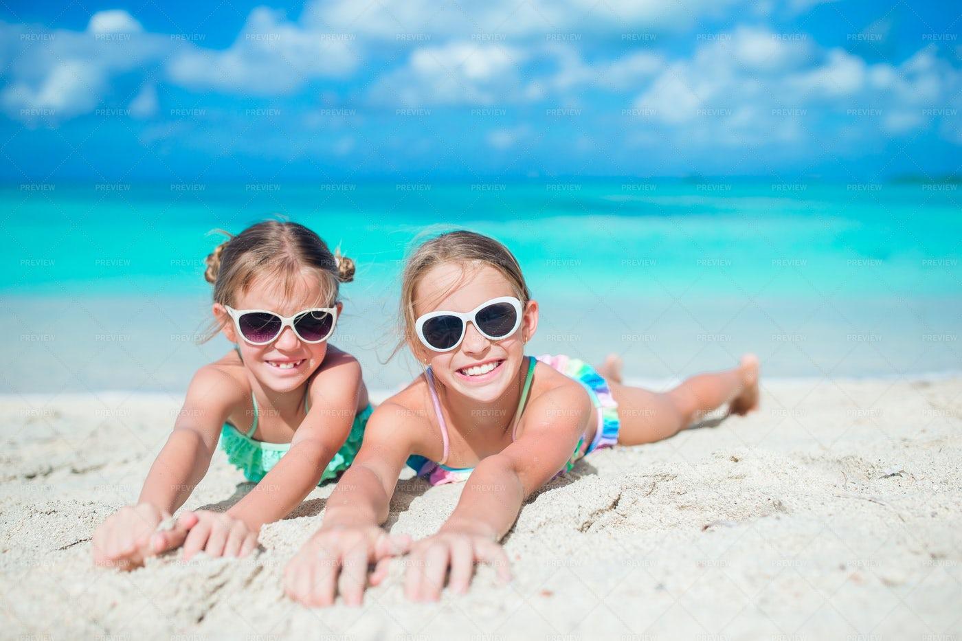 Sisters On Sandy Beach: Stock Photos