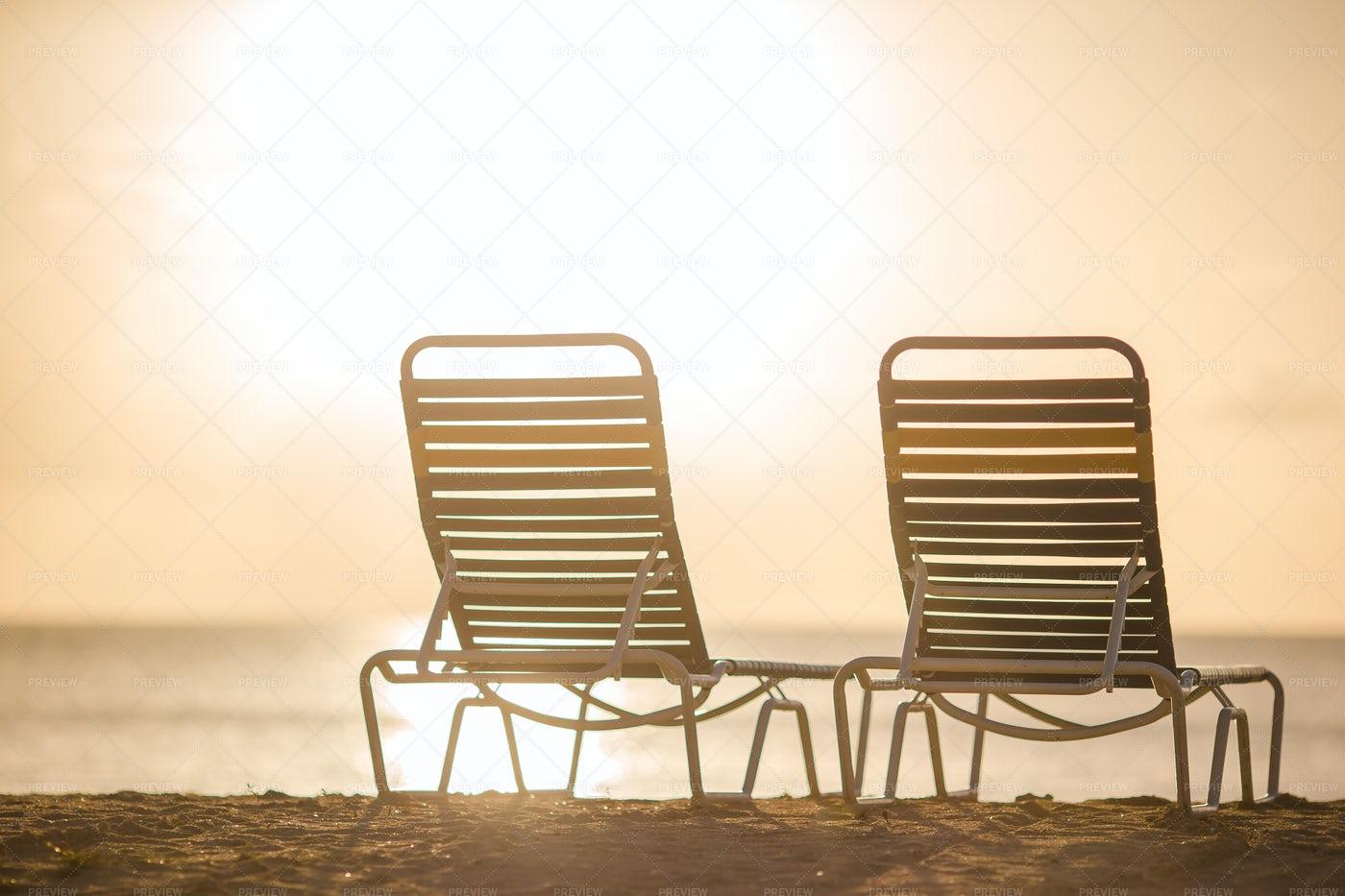 Lounge Chairs On Sunlit Beach: Stock Photos
