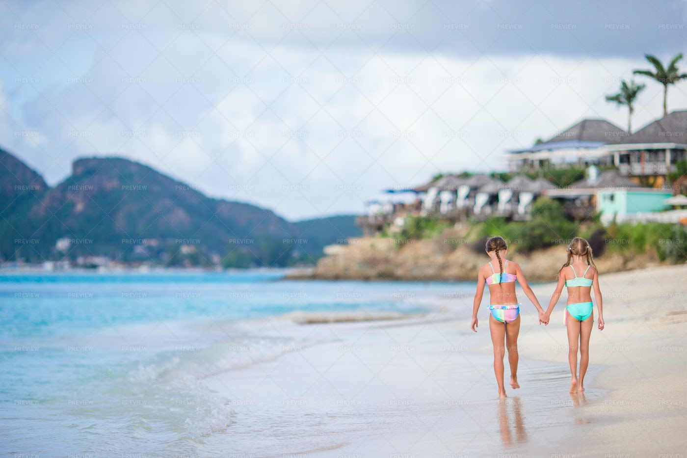 Girls Walking Along The Beach: Stock Photos