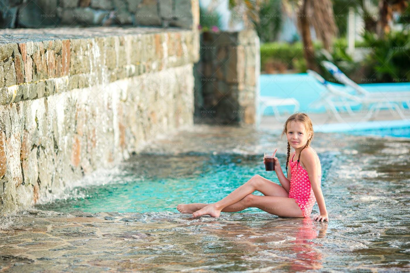 Girl Relaxing In Pool: Stock Photos