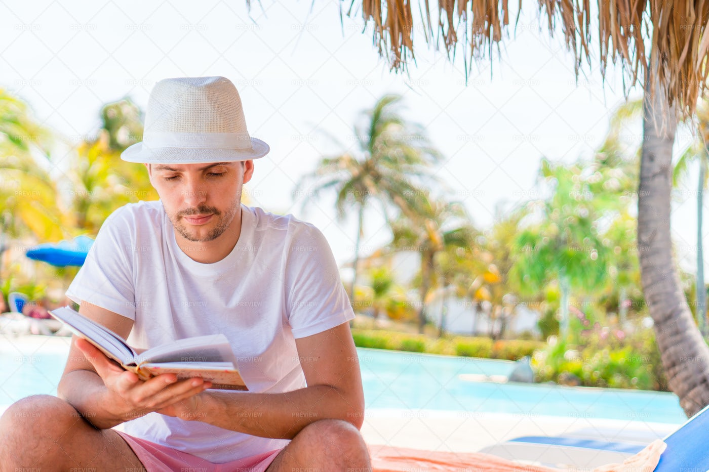 Reading By The Pool: Stock Photos