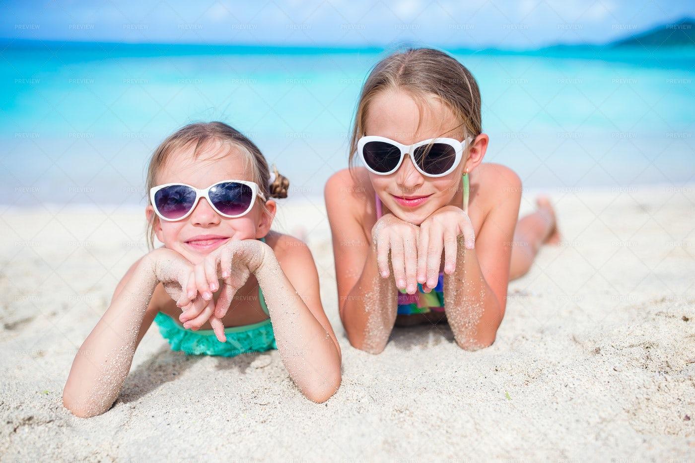 Girls Lying On The Beach: Stock Photos