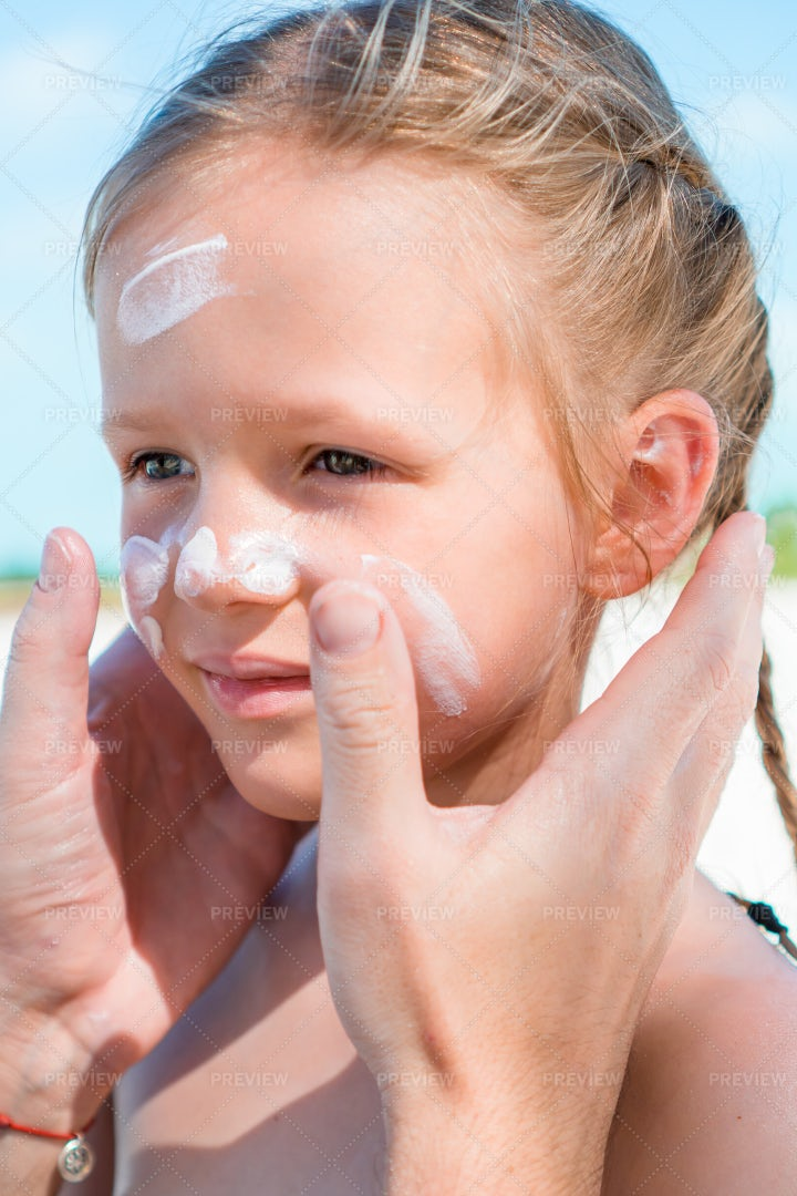 Applying Sunblock To Child's Face: Stock Photos