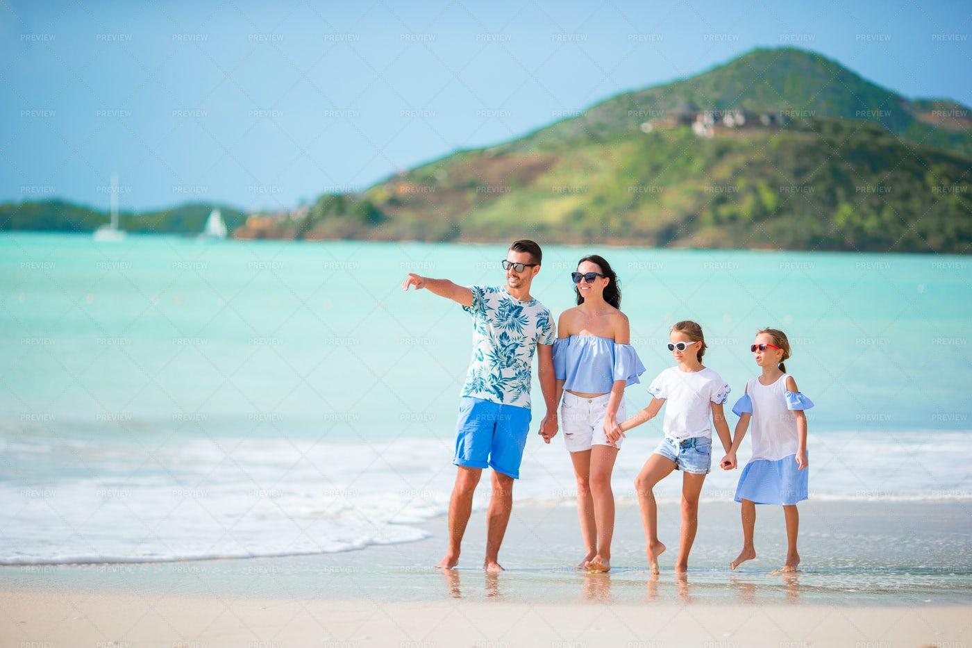 Joyful Family At The Beach: Stock Photos