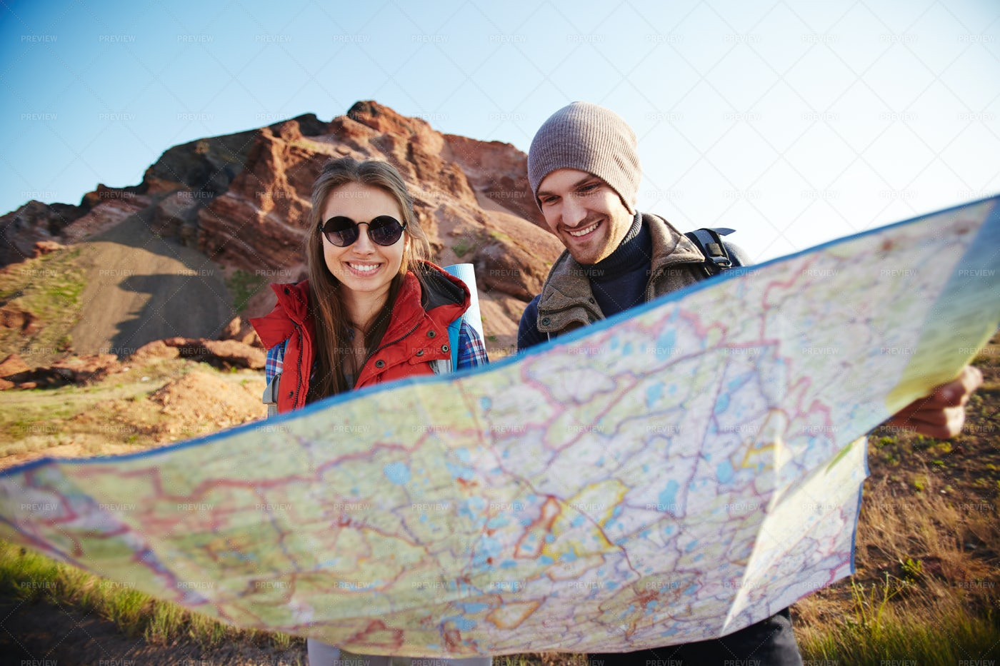 Couple Of Tourists Looking At Map: Stock Photos