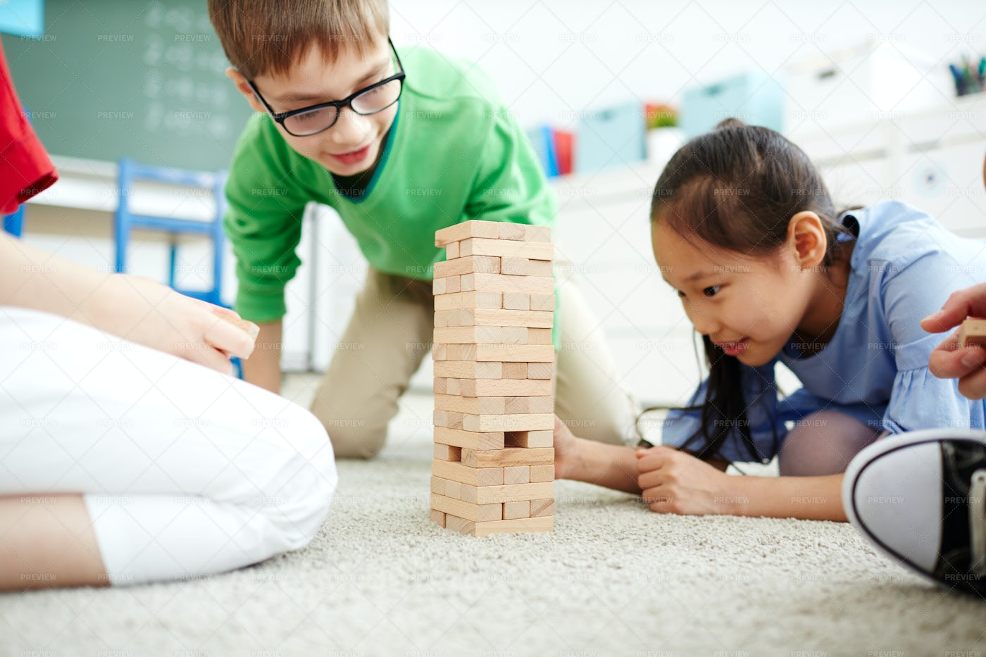 Children Playing With Wooden Tower: Stock Photos