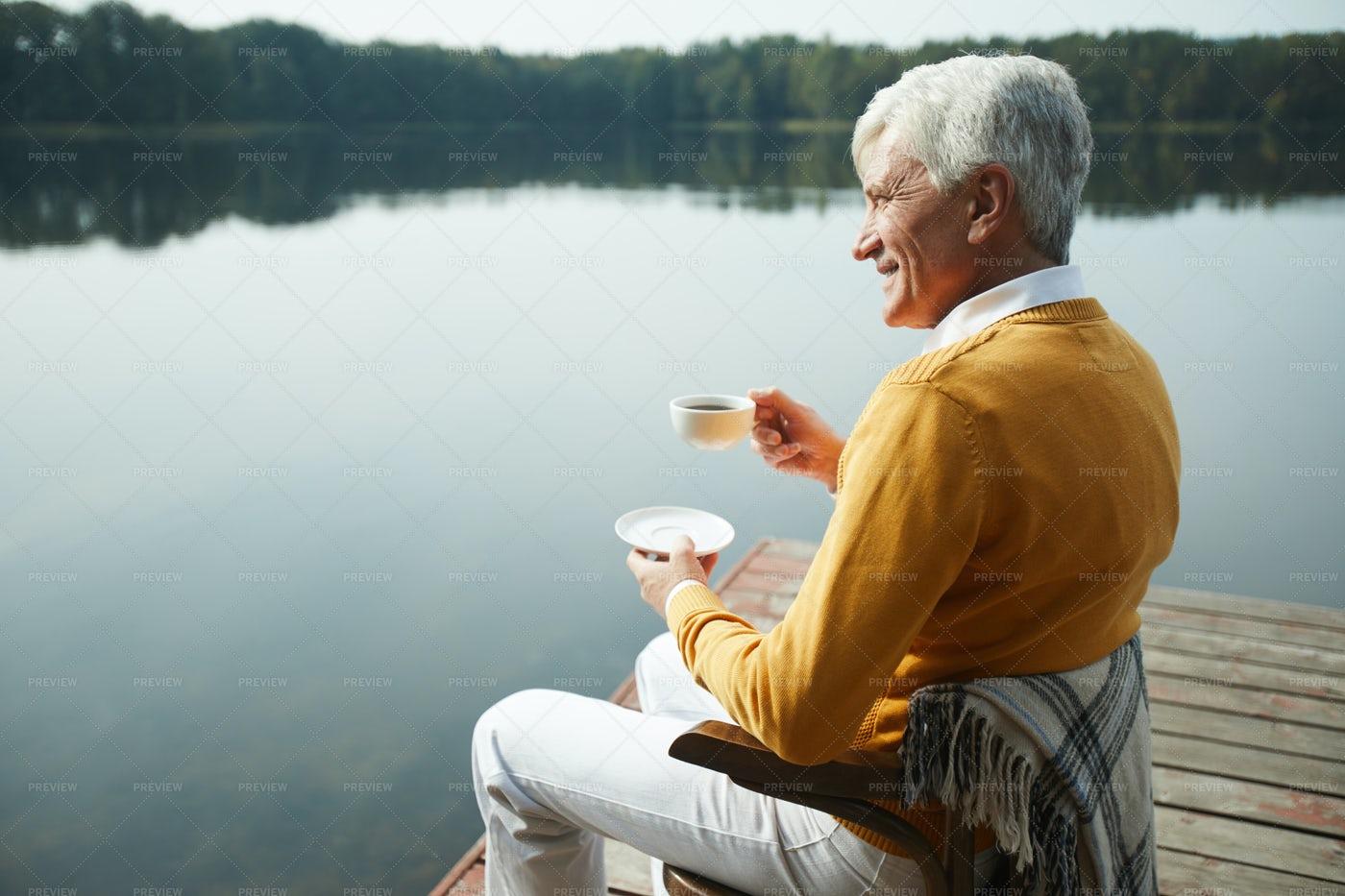 Drinking Coffee On Pier: Stock Photos