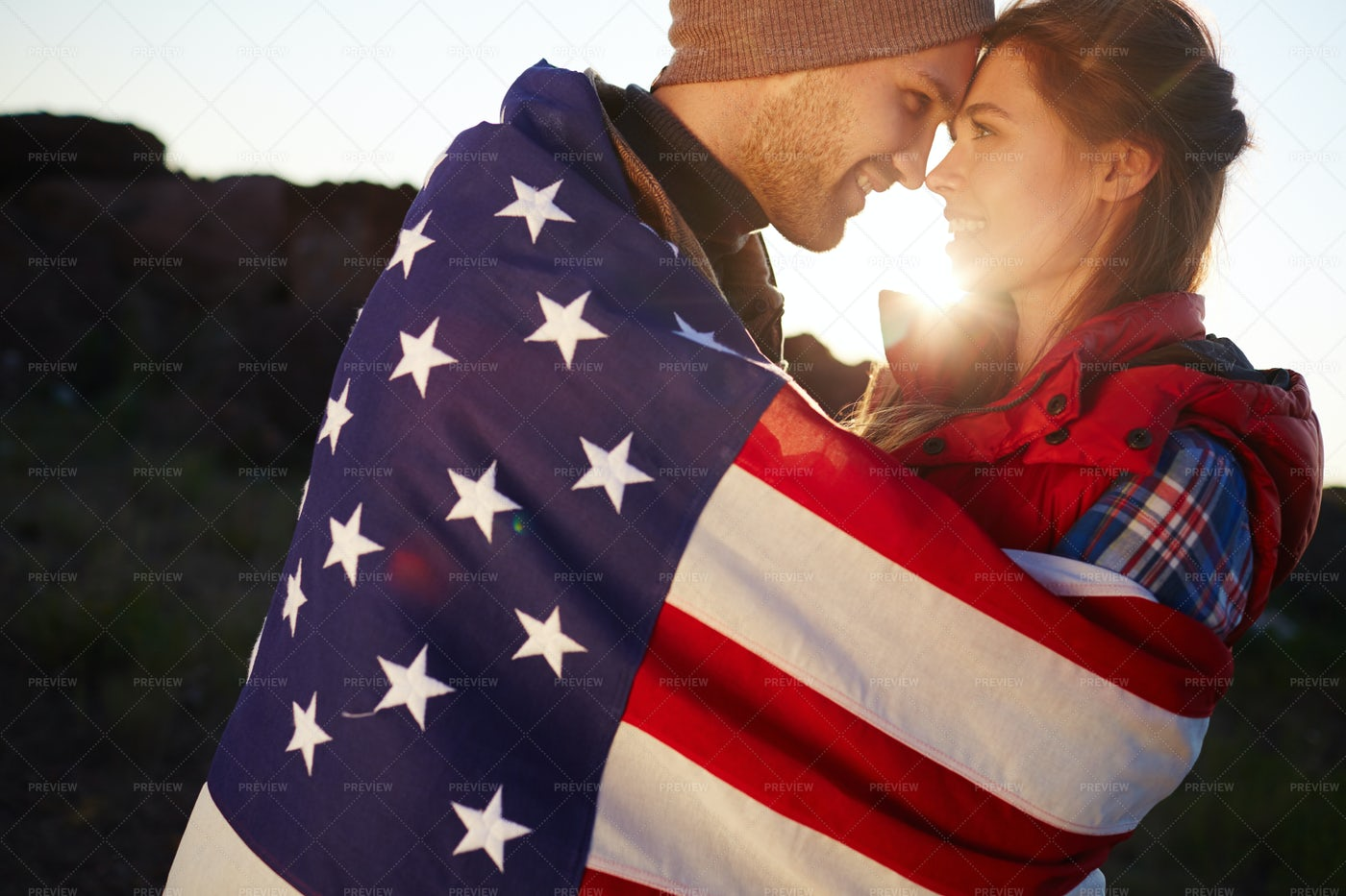 Romantic American Couple At Sunset: Stock Photos