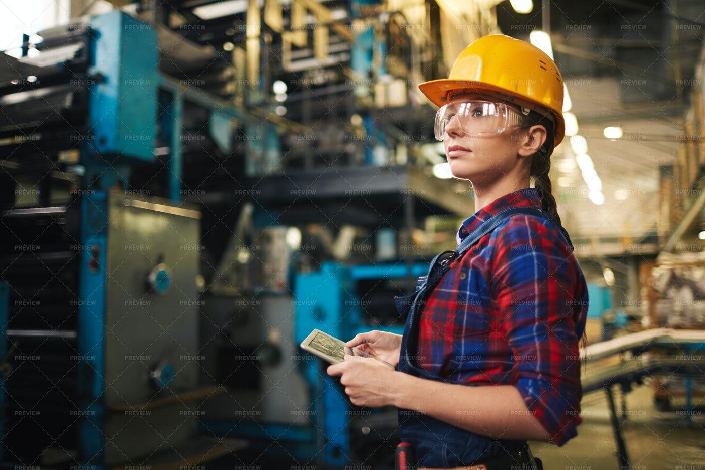 Female Employee Doing Checklist: Stock Photos