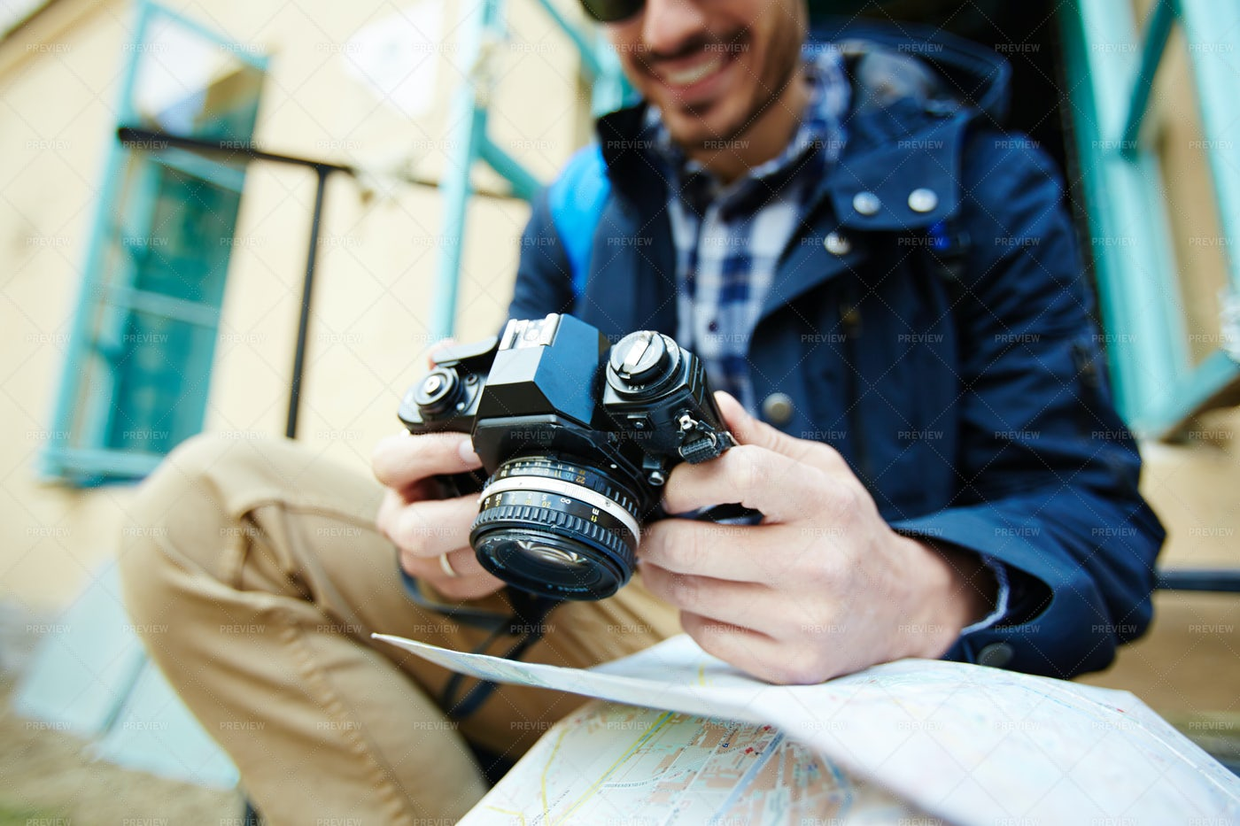 Modern Tourist Browsing Photos In Cam: Stock Photos