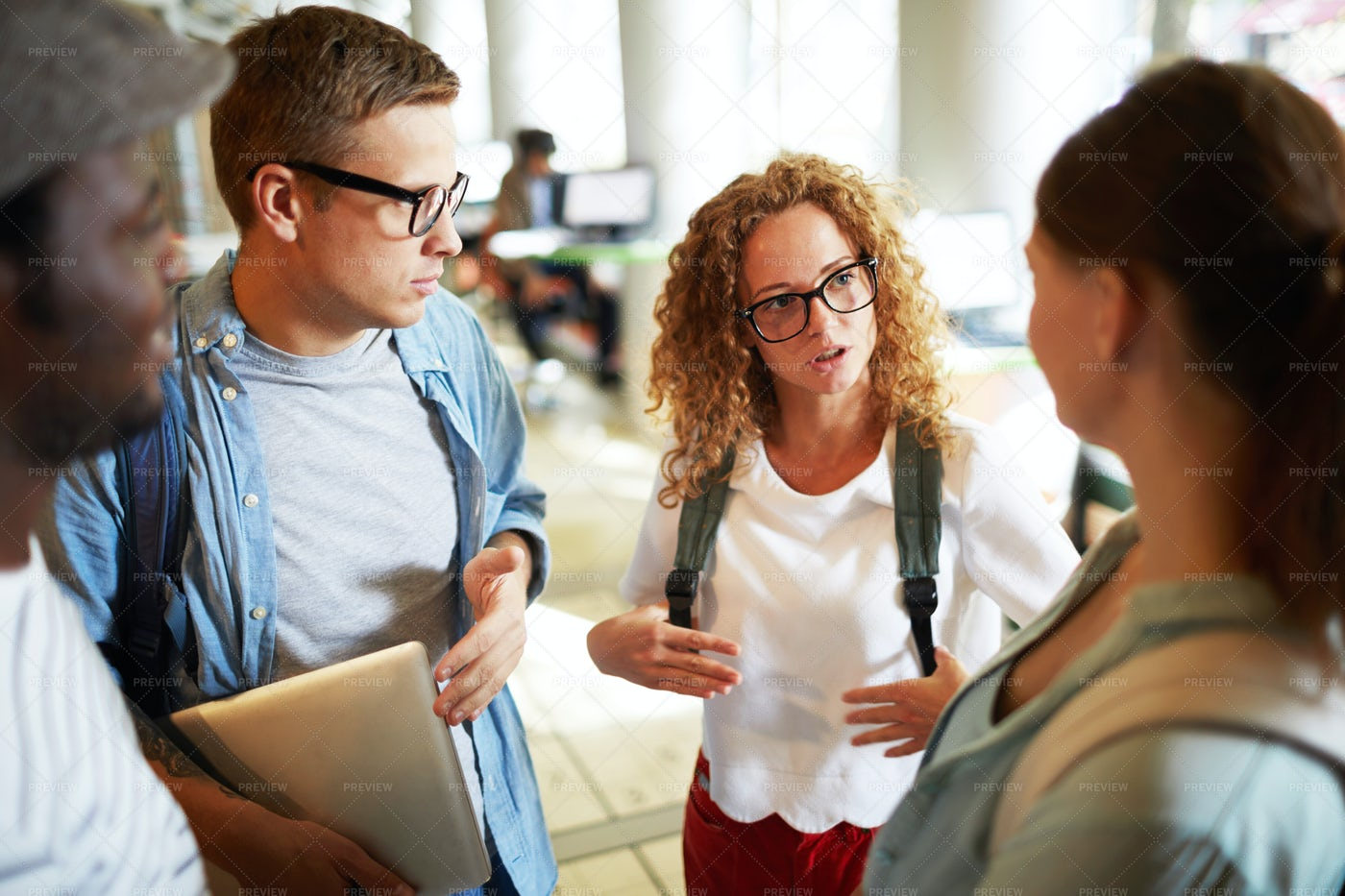 Discussing Timetable: Stock Photos
