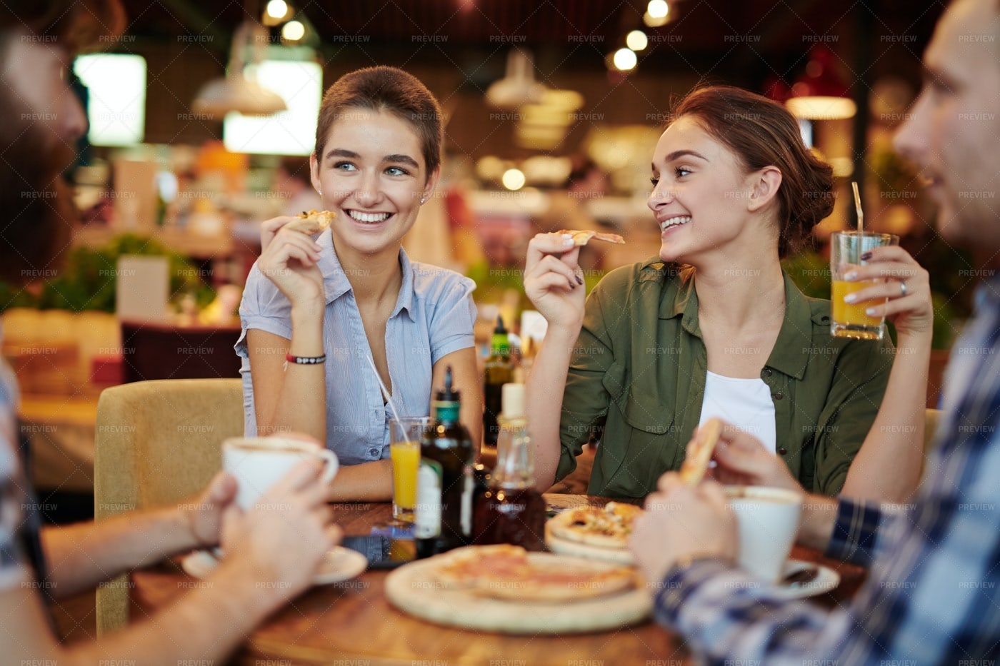 Get-together In Pizza Restaurant: Stock Photos