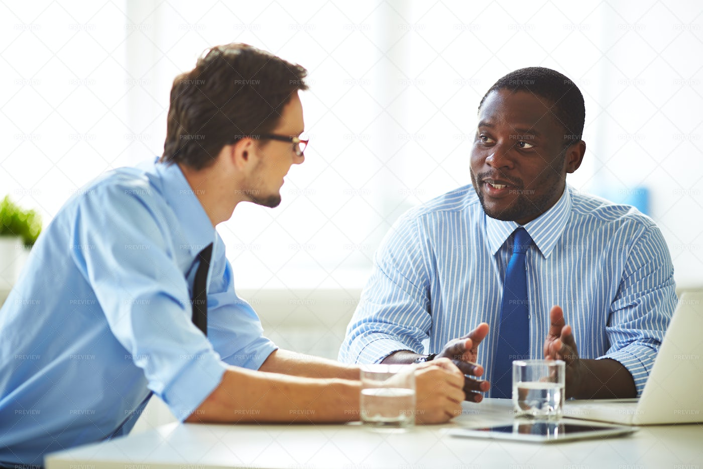 Project Discussion In Meeting Room: Stock Photos
