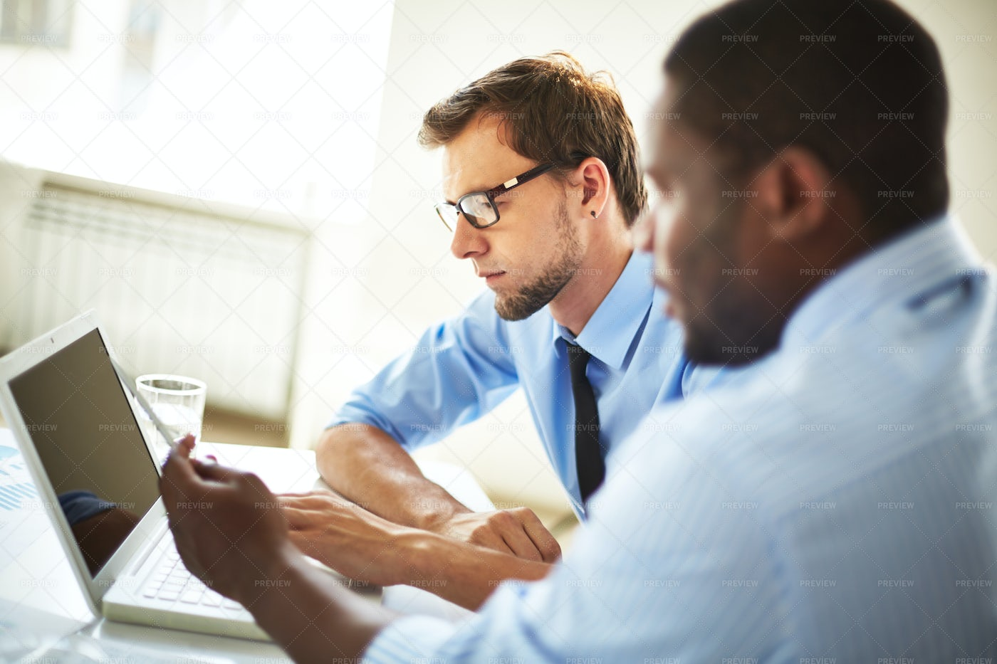 Financial Managers Wrapped Up In Work: Stock Photos