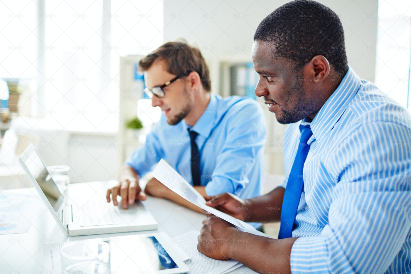 Hard-working Employees In Boardroom: Stock Photos