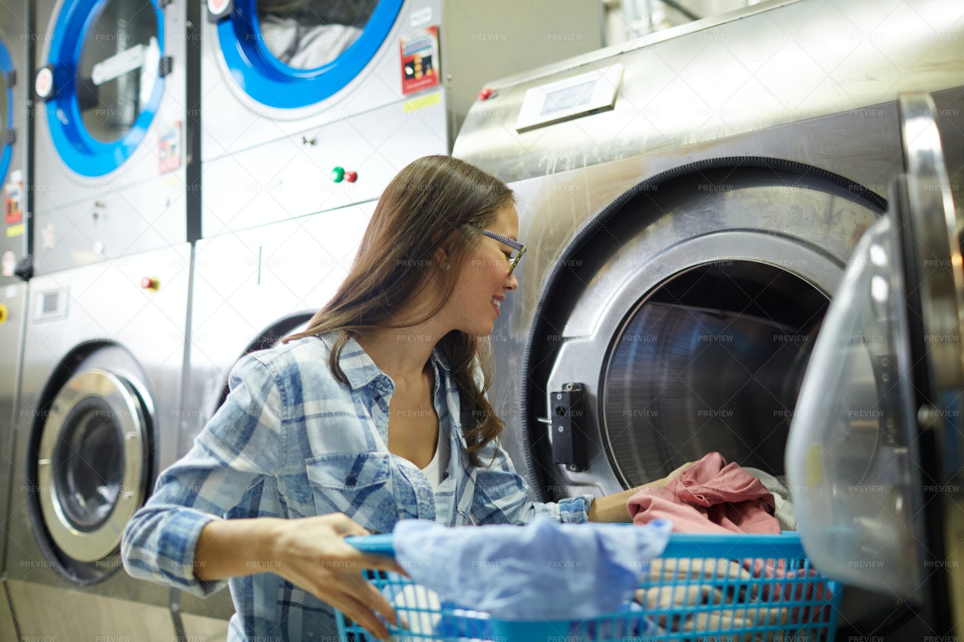 Working As Laundress: Stock Photos