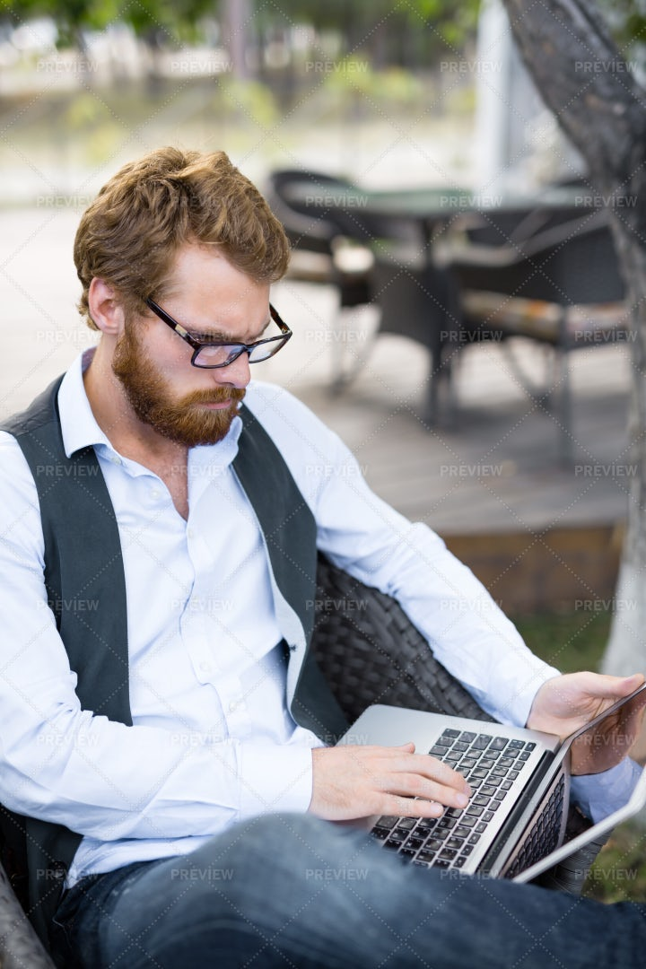 Red-haired Trader Working In Patio: Stock Photos