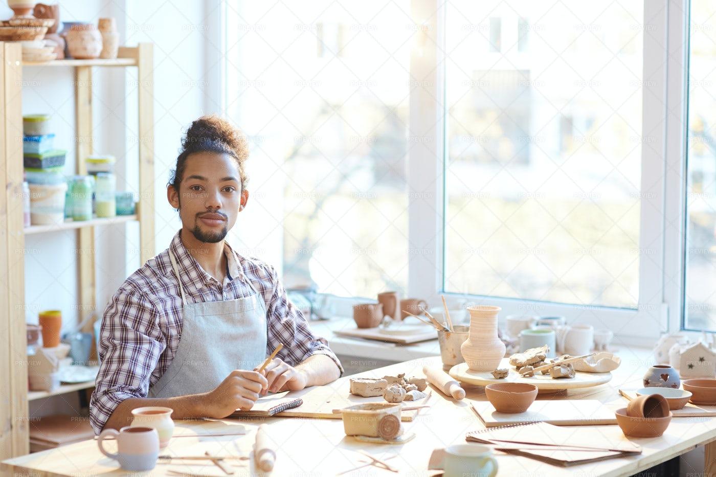 Confident Potter In Workshop: Stock Photos