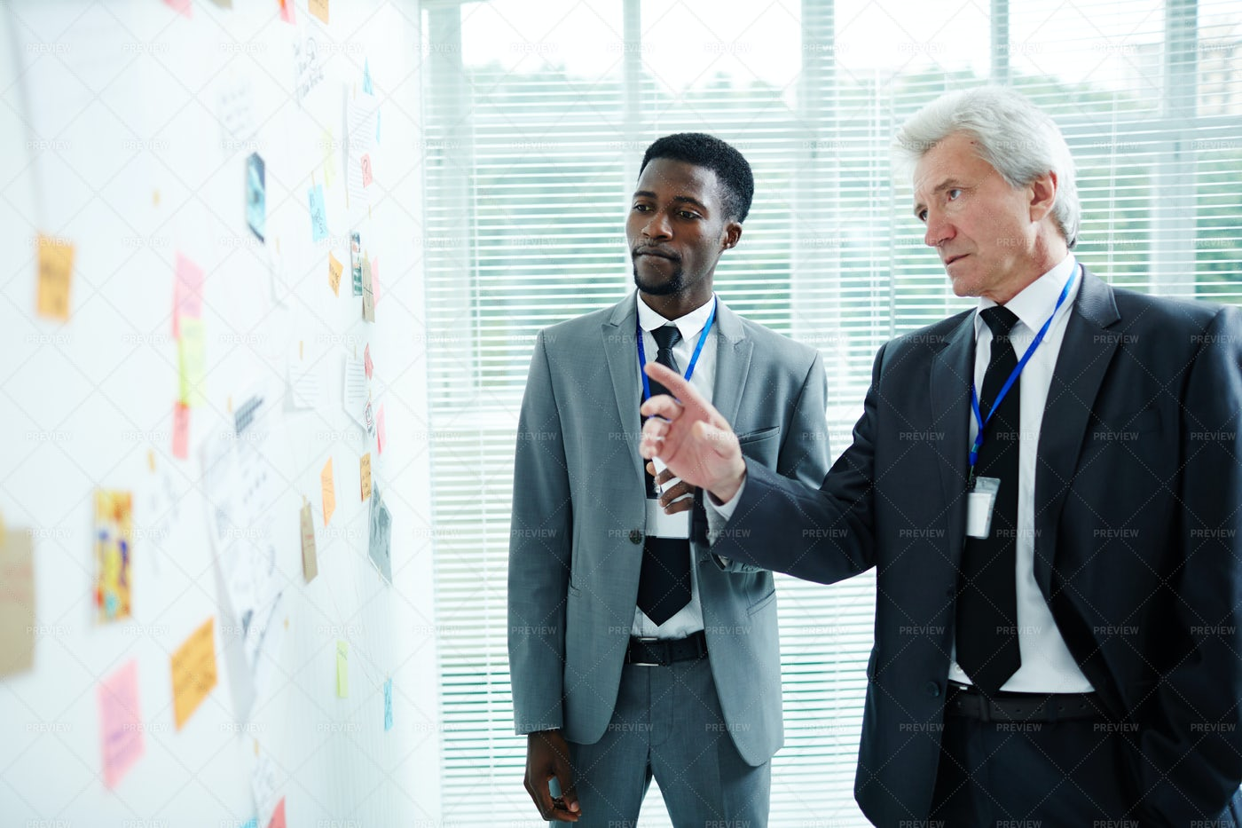 Detectives Sharing Ideas With Each Other: Stock Photos
