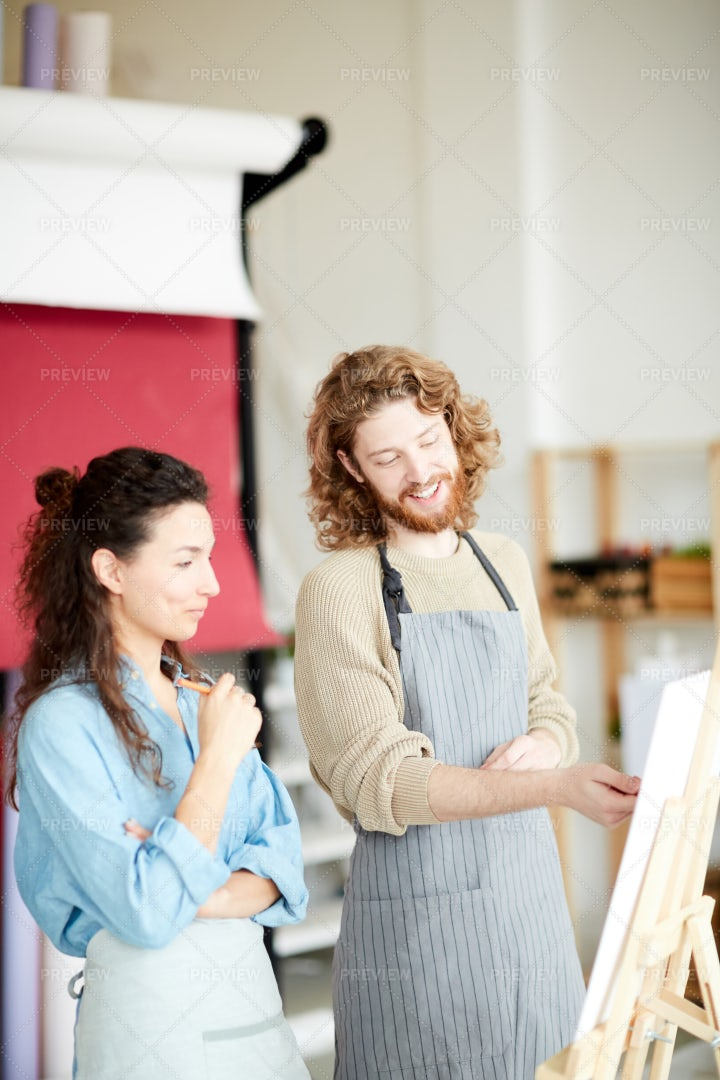 Colleagues By Easel: Stock Photos