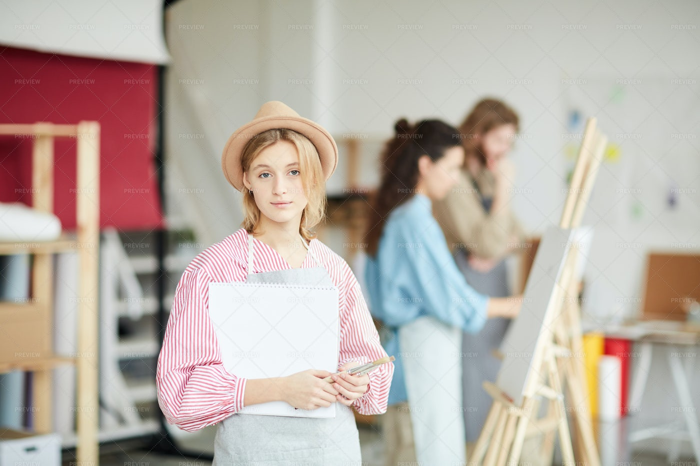 Girl With Painting Supplies: Stock Photos