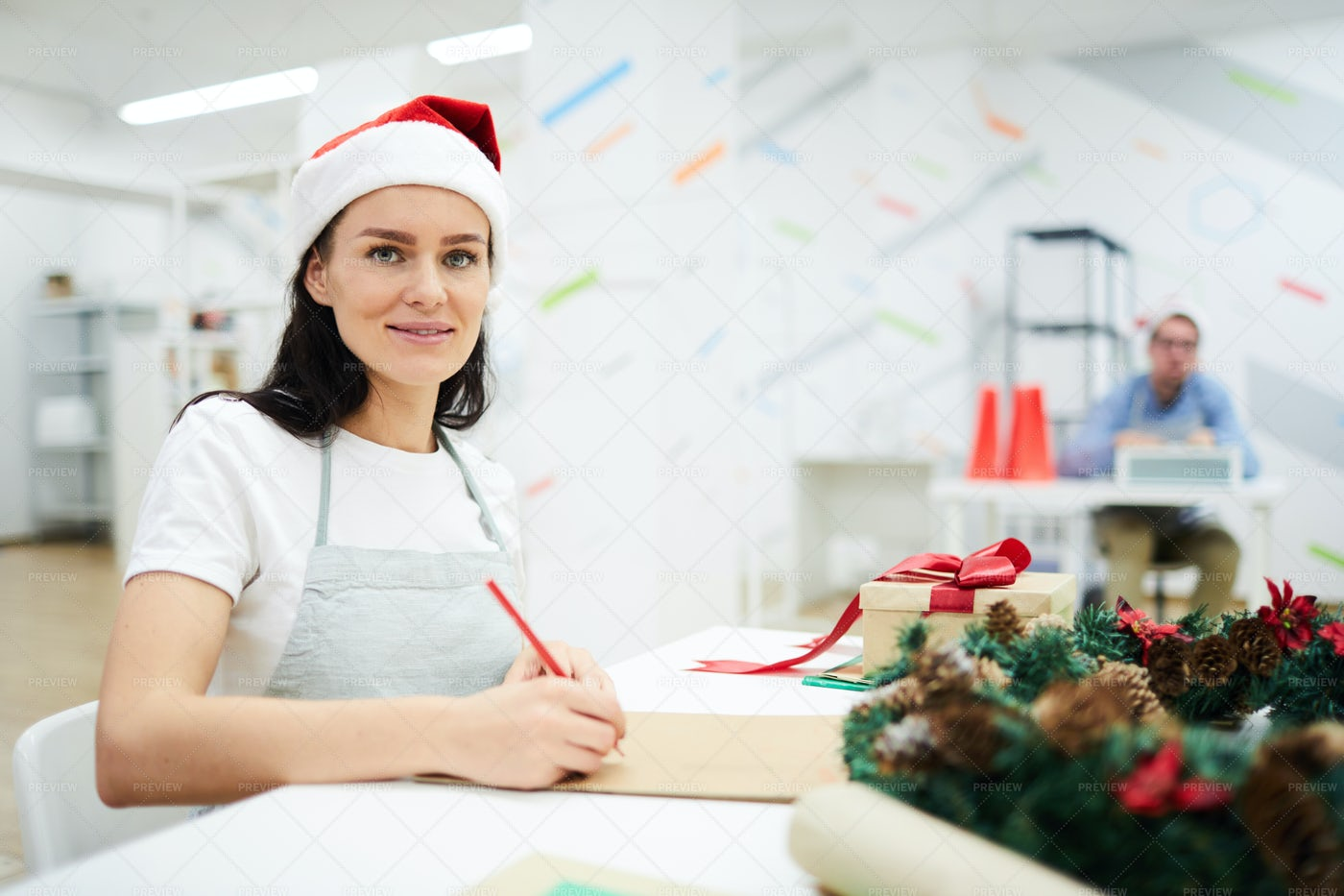 Smiling Lady Drawing In Sketchpad: Stock Photos