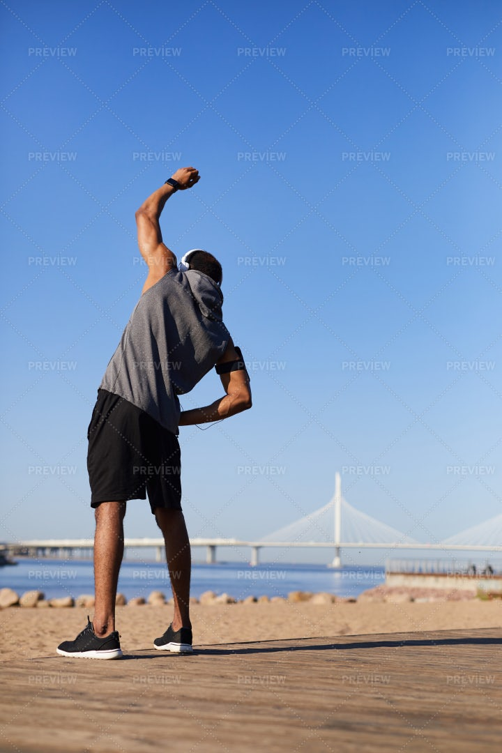 Man Performing Side Bend Stretch: Stock Photos