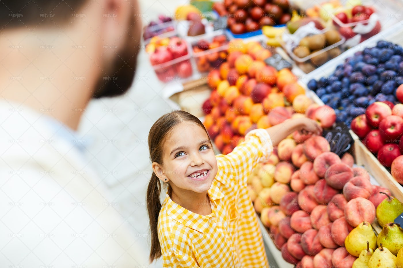 Happy Daughter Wanting Fruits: Stock Photos