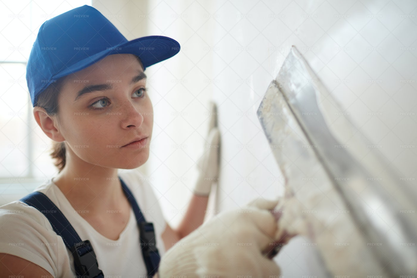 Woman Plastering Walls With Spatula: Stock Photos