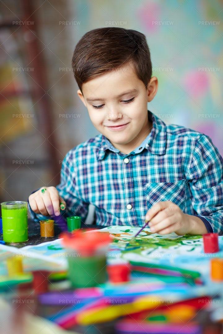 Boy Painting: Stock Photos