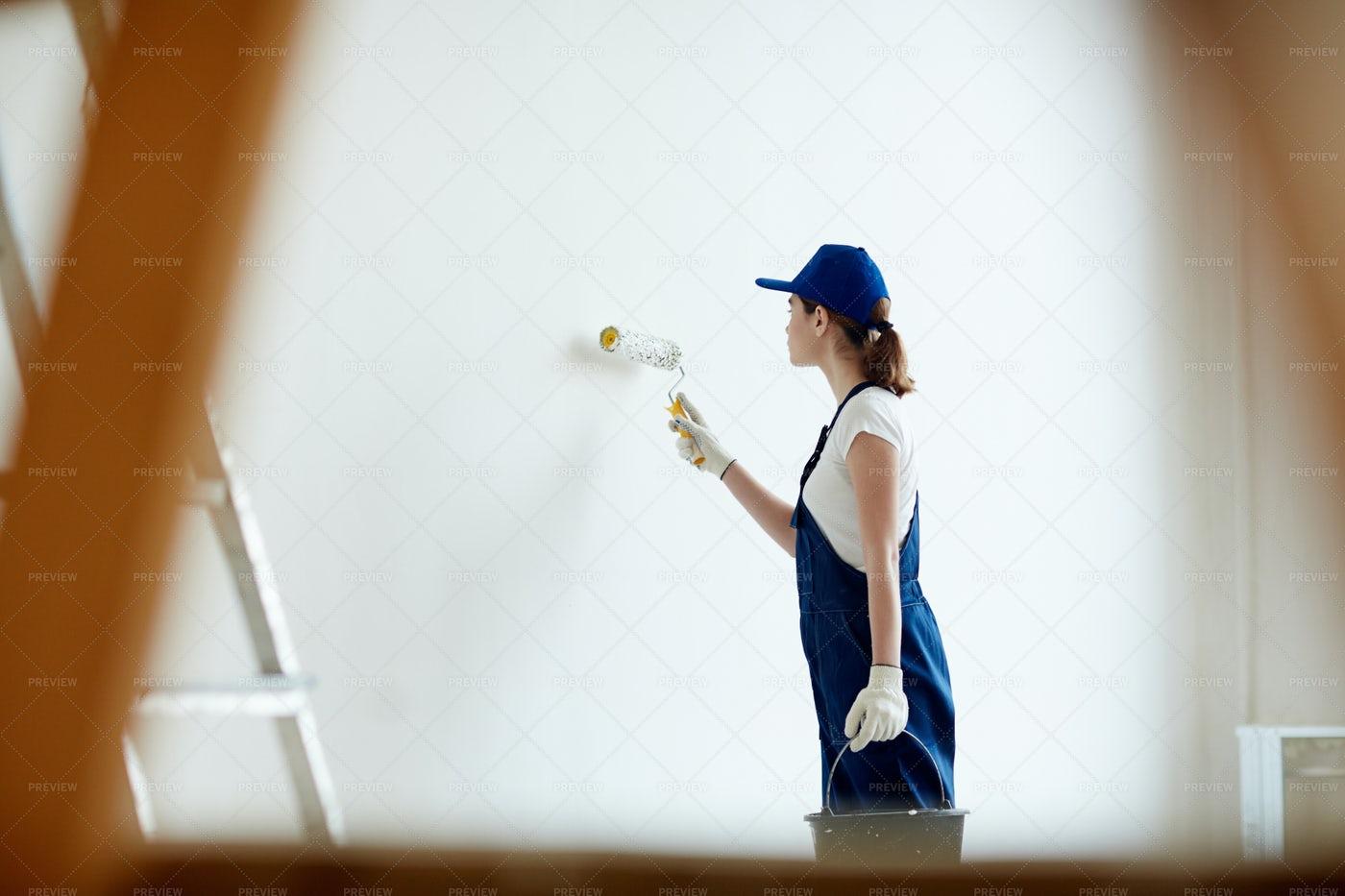 Female Painter Whitewashing Walls: Stock Photos