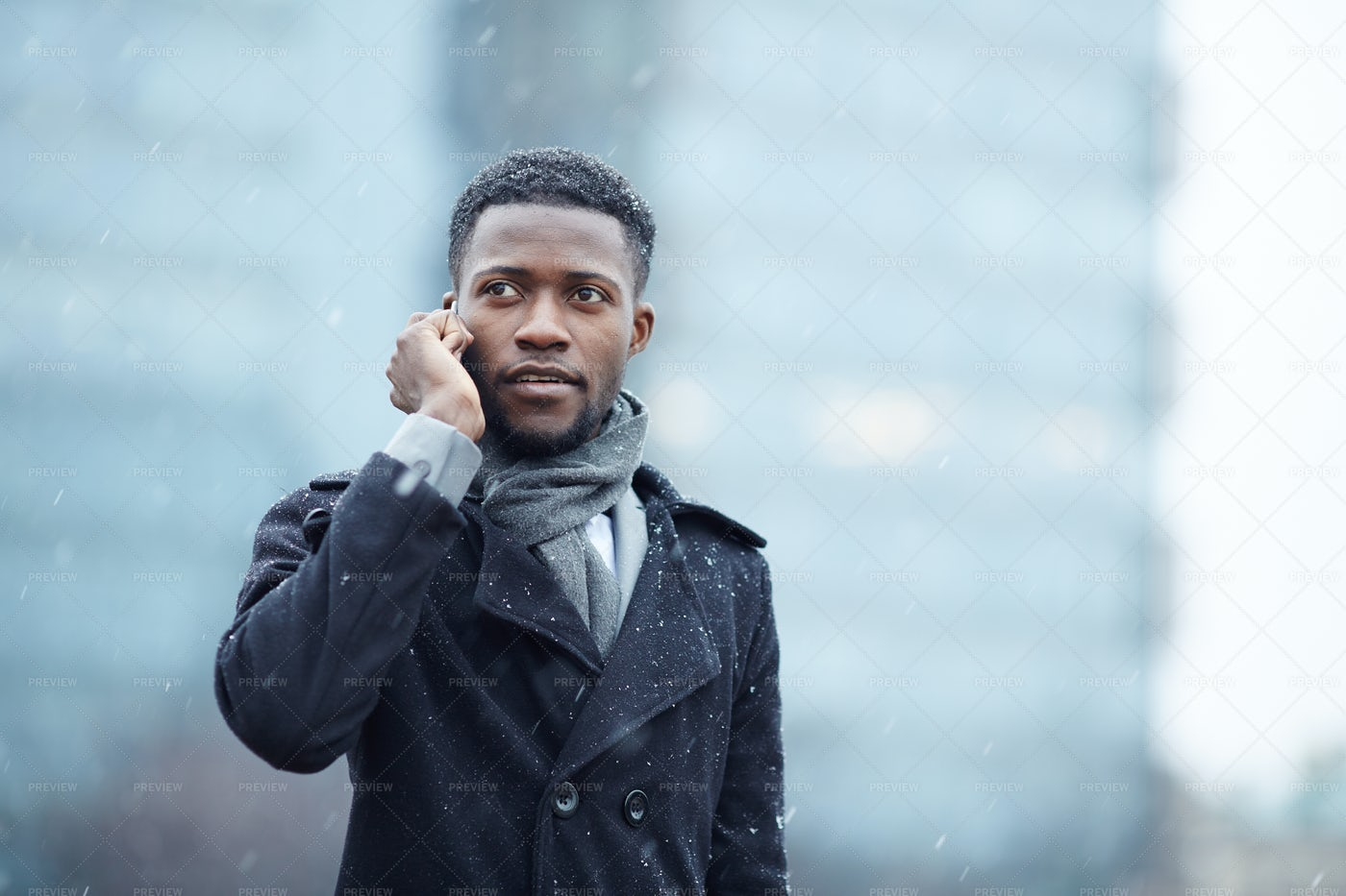 Handsome African Man On Phone In Street: Stock Photos