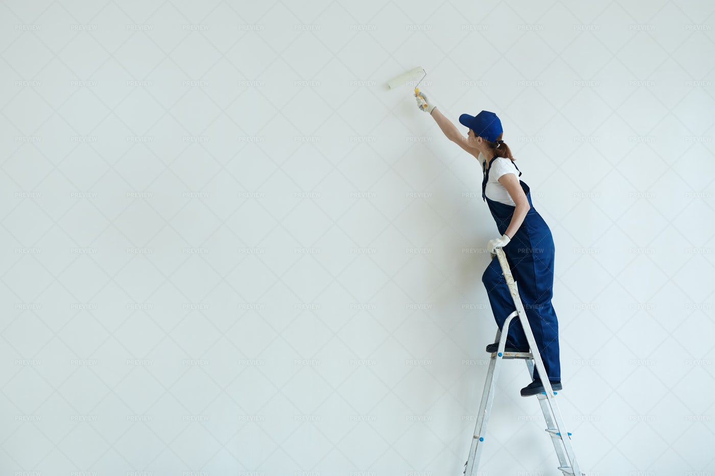 Woman Painting White Wall: Stock Photos