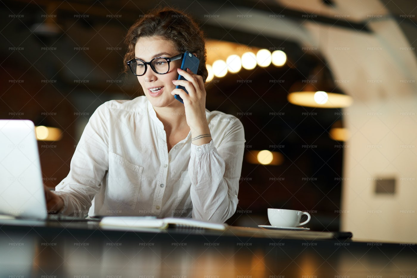 Phoning In Cafe: Stock Photos