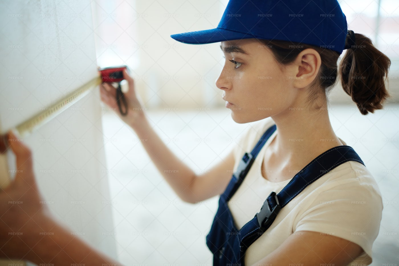 Female Worker Remodeling Space: Stock Photos