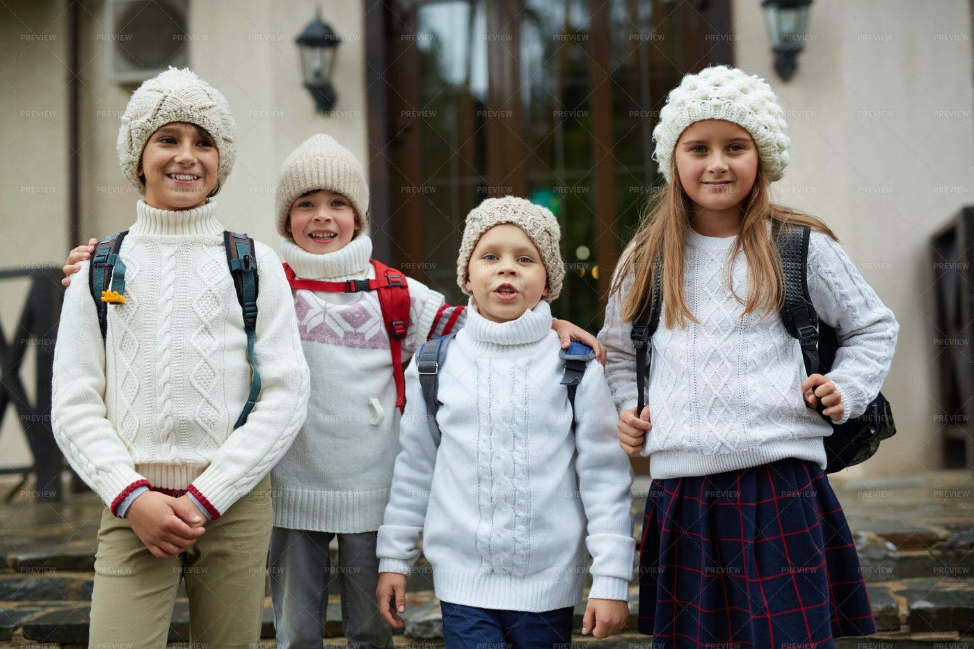 Group Of Children Posing By School Door: Stock Photos