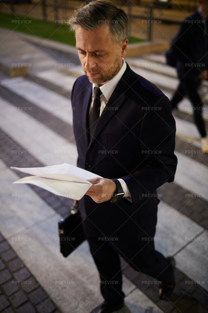 Crossing Road And Reading: Stock Photos