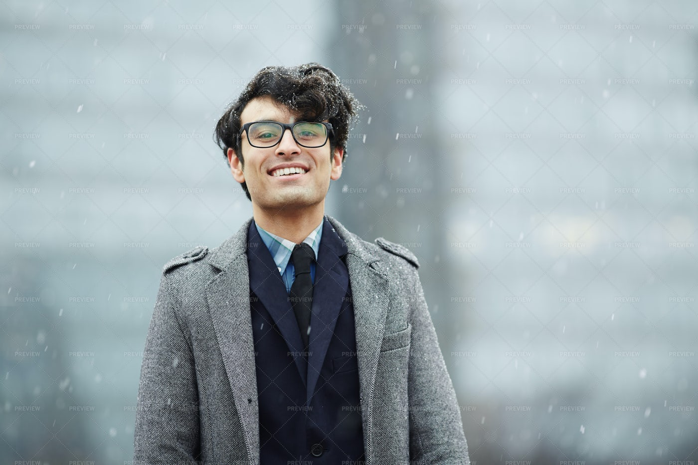 Smiling Young Businessman In Snow: Stock Photos