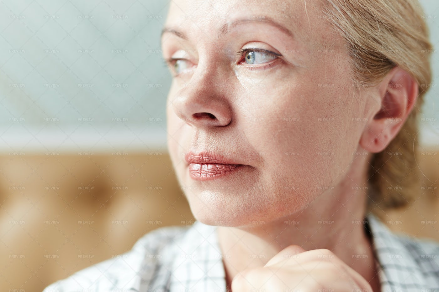 Portrait Of Pensive Middle-Aged Woman: Stock Photos