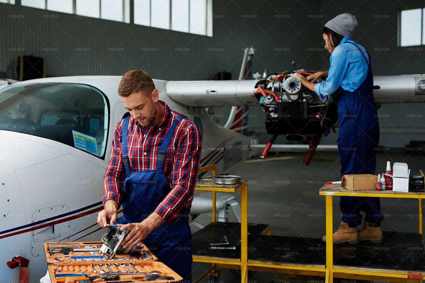 Engineers Repairing Airplane Turbine: Stock Photos