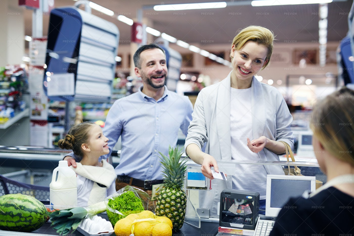 Family By Supermarket Checkout: Stock Photos