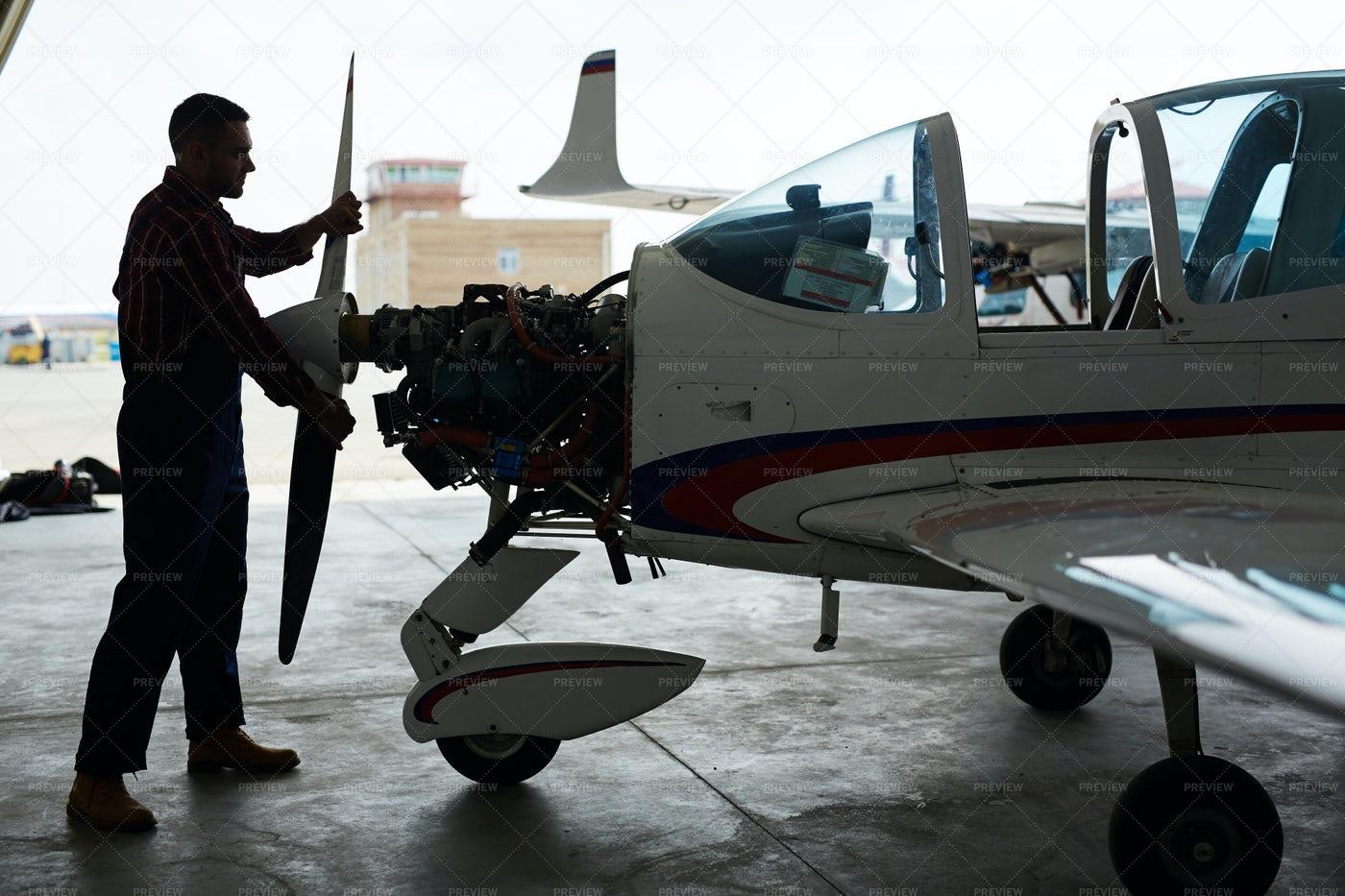 Mechanic Working With Airplane In Hangar: Stock Photos