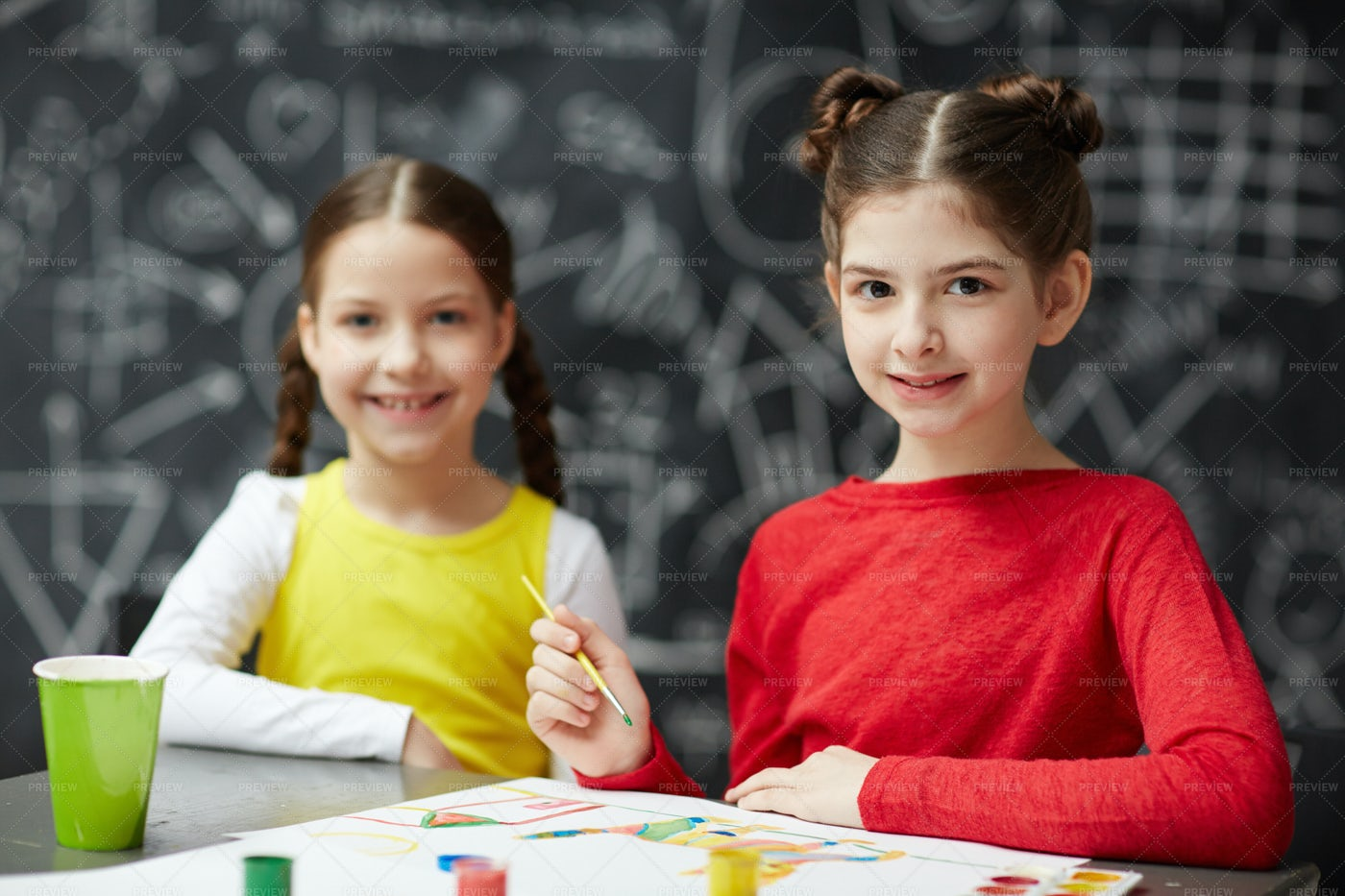 Two Little Girls Painting Together: Stock Photos
