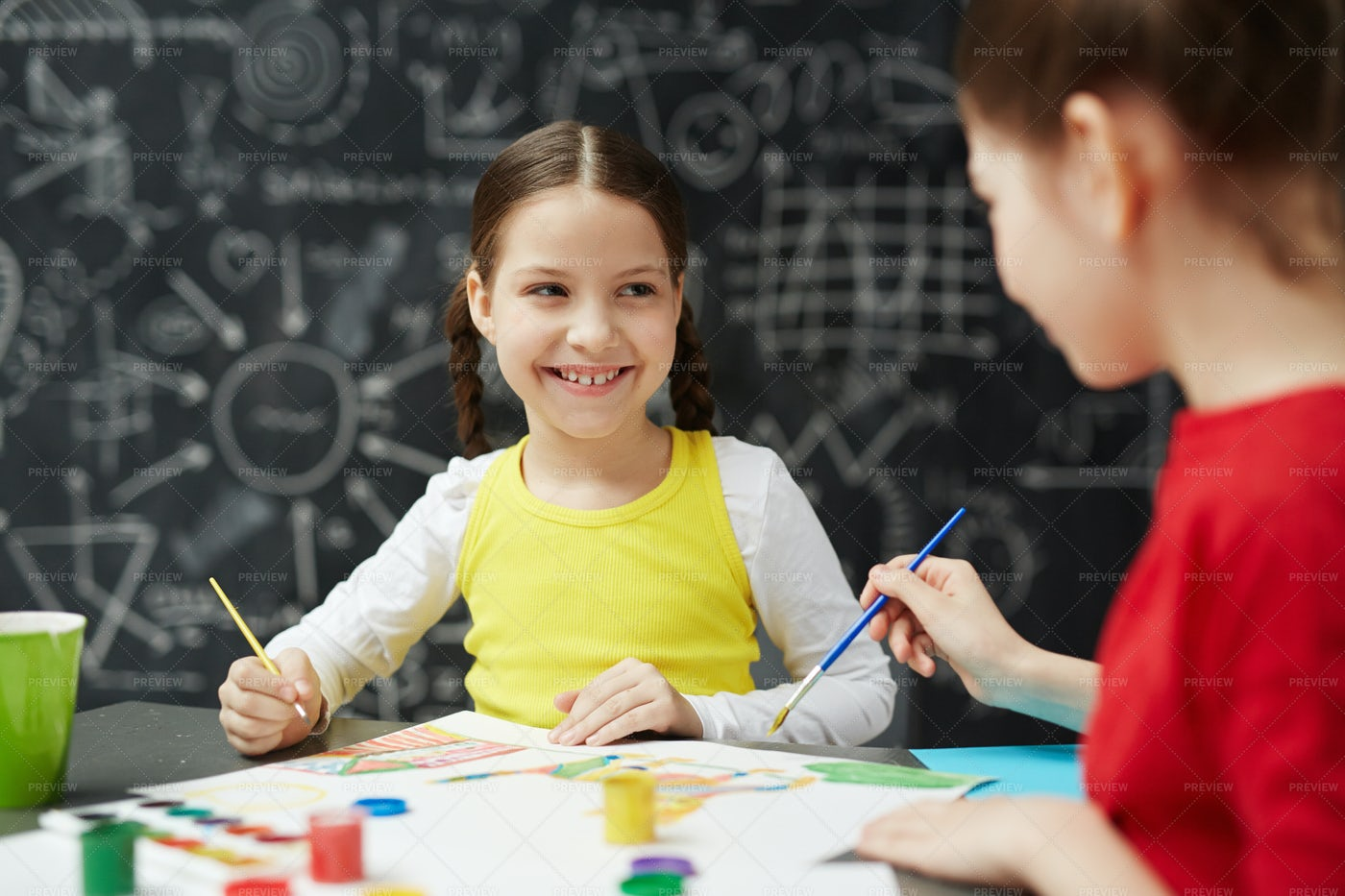 Cute Girl Painting In Art Class: Stock Photos
