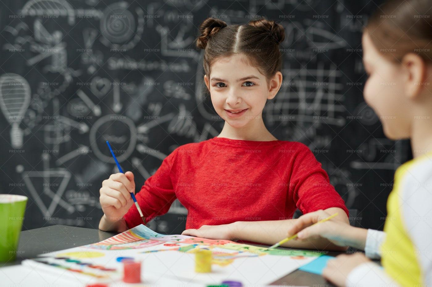Smiling Schoolgirl Painting In Art Class: Stock Photos