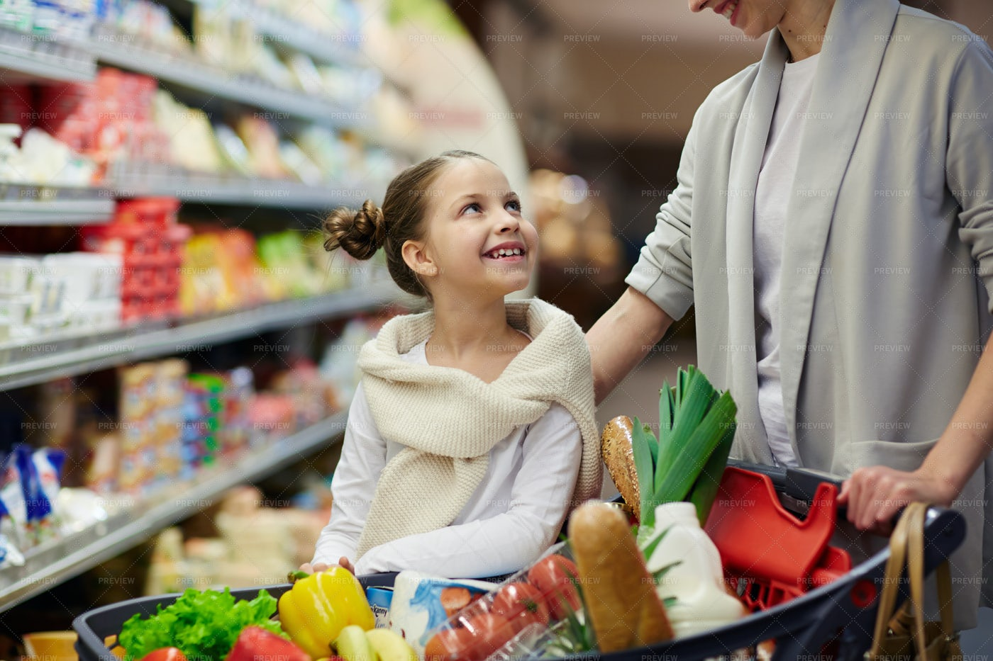 Talking To Mother In Supermarket: Stock Photos