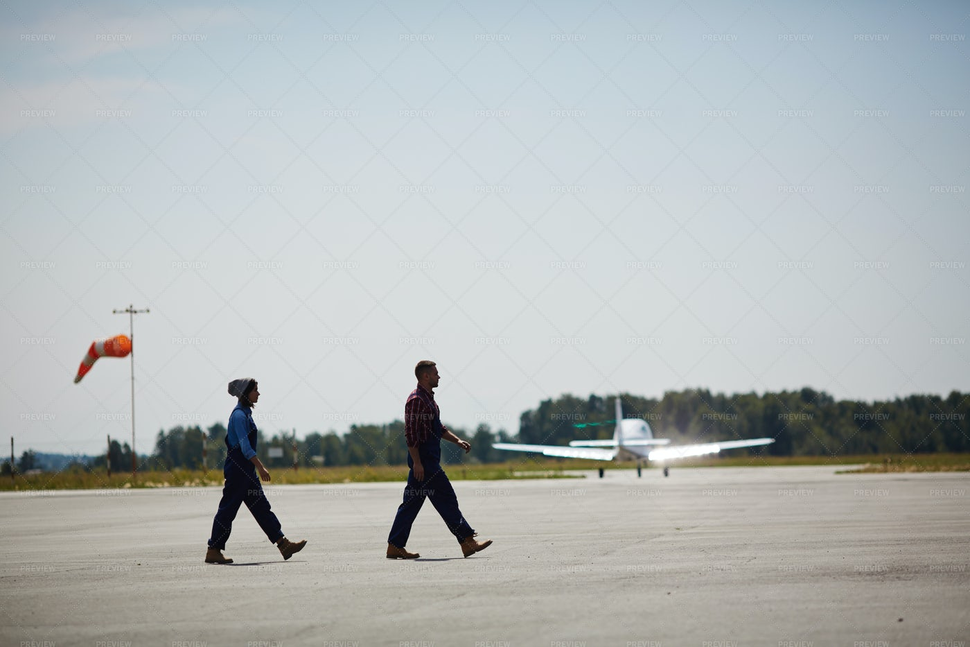 Airport Workers On Runway Field: Stock Photos