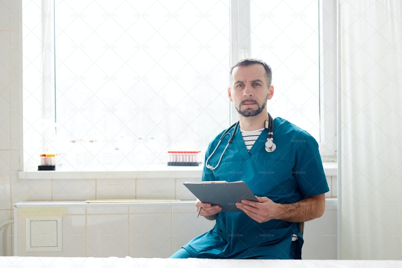 Clinician With Document: Stock Photos